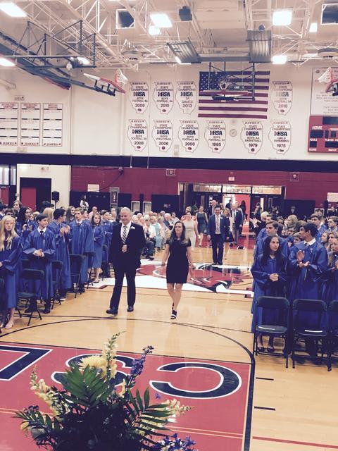 Staff processing into graduation