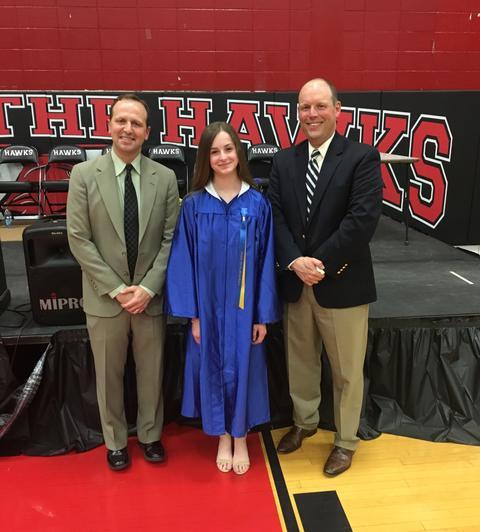 Graduate poses Principal and Assistant Principal
