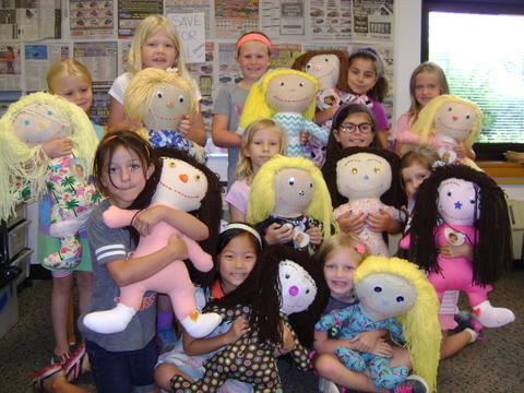 Students with ME dolls they made in class