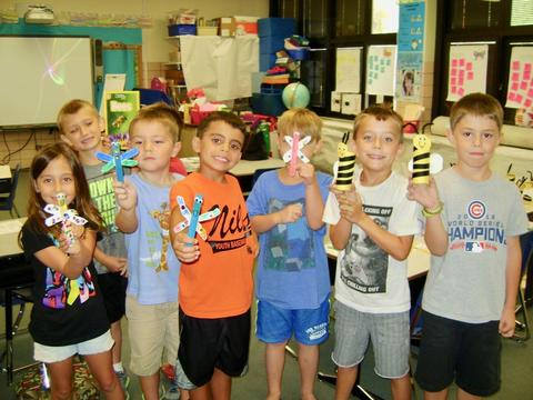 Students display bee and butterfly creations