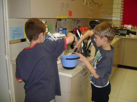 Boys stirring in a bowl