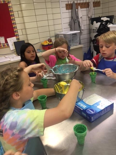 Students mixing colorful frosting