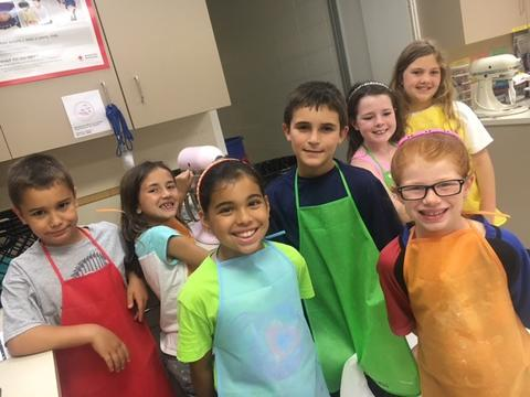 Group of students in aprons