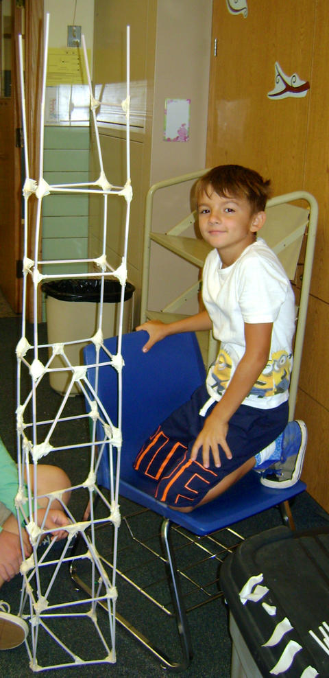 Boy with his tower stucture
