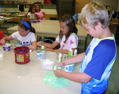 Students creating colorful dough