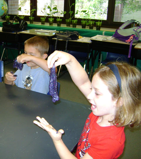 Students playing with glittery creation