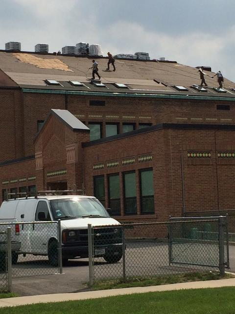 Workmen on Roosevelt's Roof