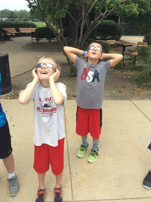 Two students viewing the eclipse