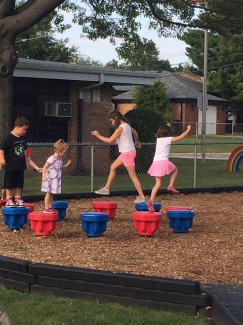 Children show off their balancing skills on the mushroom pads!
