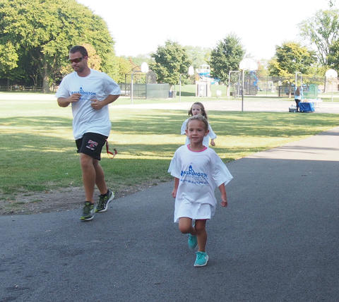 Teacher and student running on track