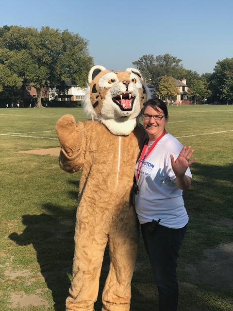 Principal and Mascot waving