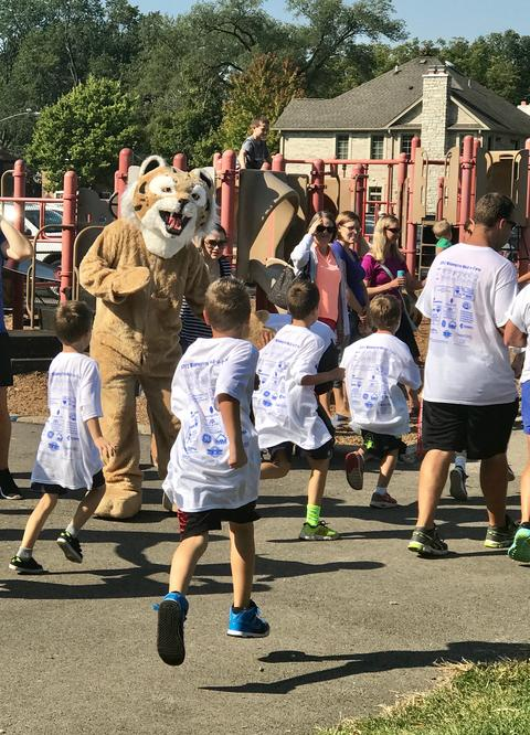 Mascot at the start of the walk cheering on students