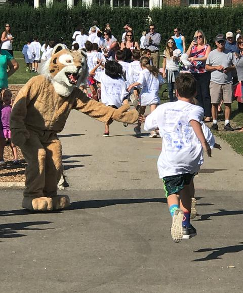 Mascot encouraging student runners