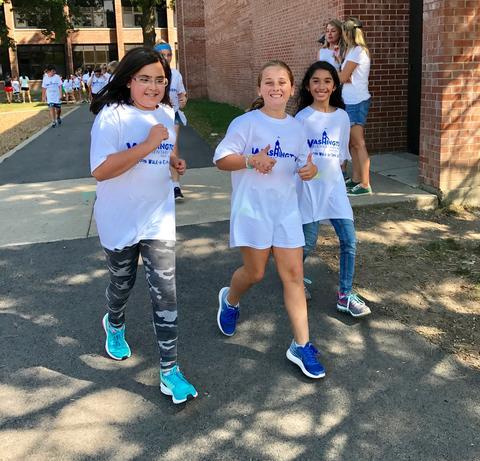Three girls running