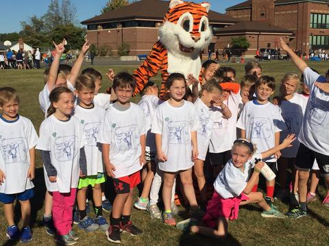 Whole class posing with Tiger mascot