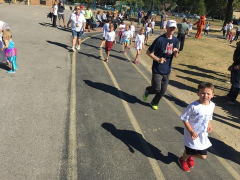 Principal Dwyer and students running
