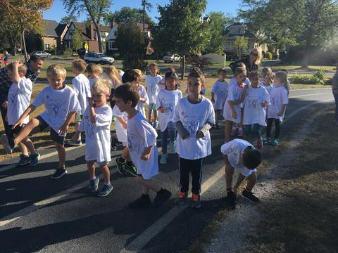 Young kids warming up for run