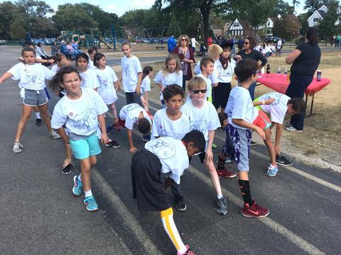 Runners limbering up before run
