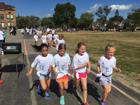Four girls running together