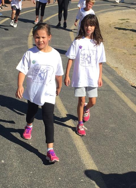 Two girls walking the track