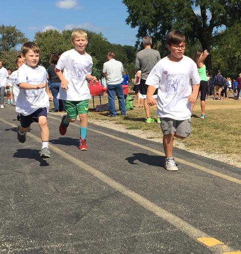 Boys running on track