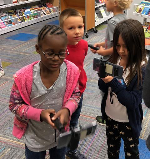 students searching with their google devices