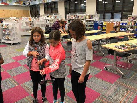 three students searching for AR finds
