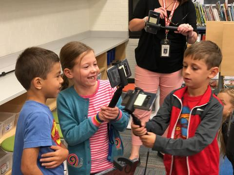 young students smiling over their AR finds