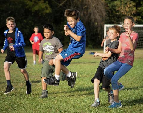 boy leaping during soccer game