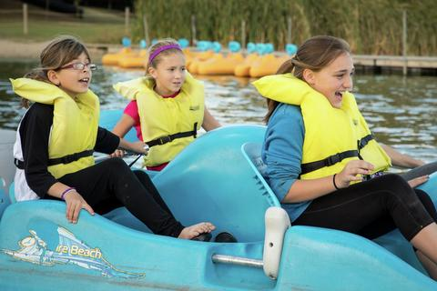 three girls in a paddle boat