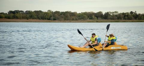 two boys out on the water in a row boat