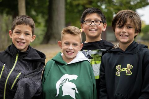 four boys smiling for the camera
