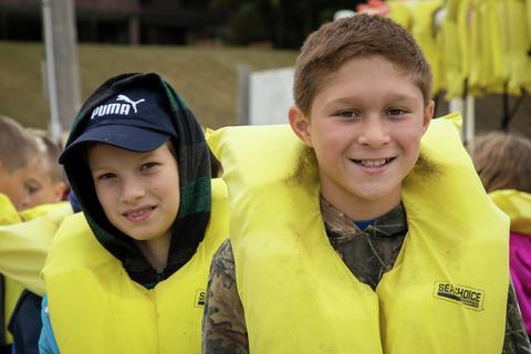 boys in life vests