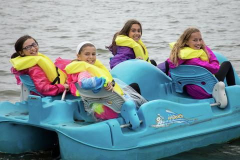 four girls in a paddle boat