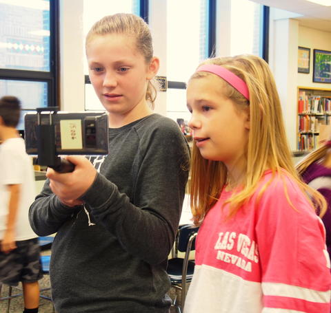 Girls using device to view images