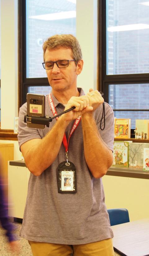 Teacher holding selfie stick