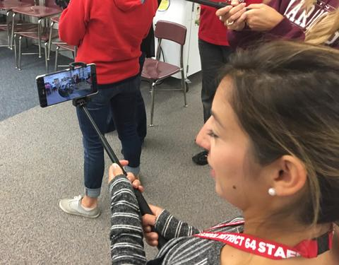 teacher viewing planet image on device