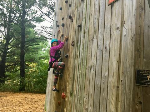 girl starting climb on the climbing wall