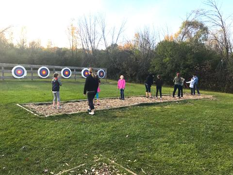 students getting set to shoot arrows