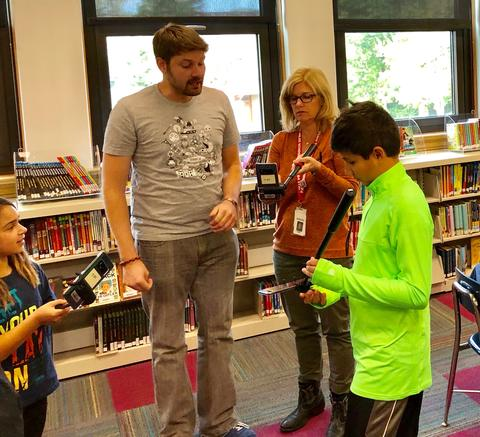 teacher and google representative work with a student