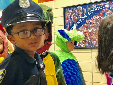 boy dressed as policeman