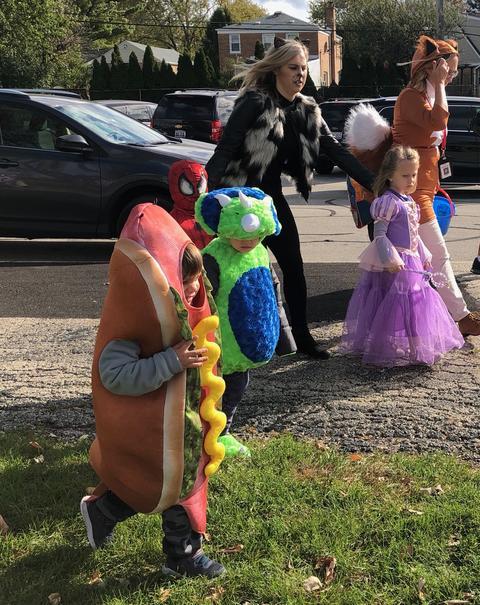 teacher sheperding students in the parade
