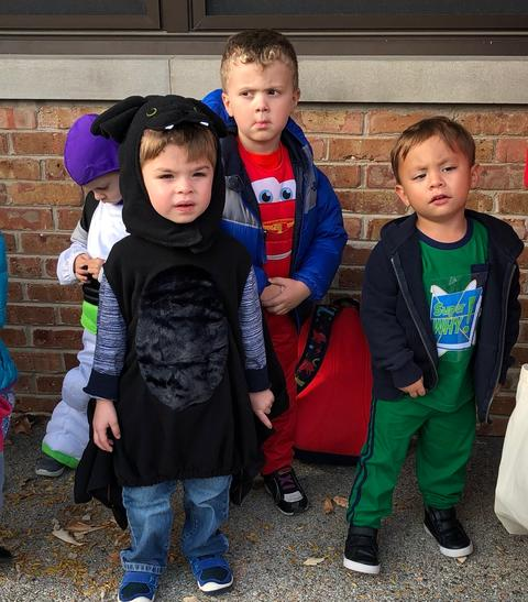 several boys in costume