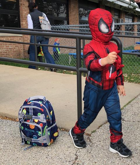 student in spiderman costume