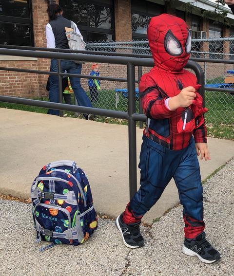 student in spiderman costume