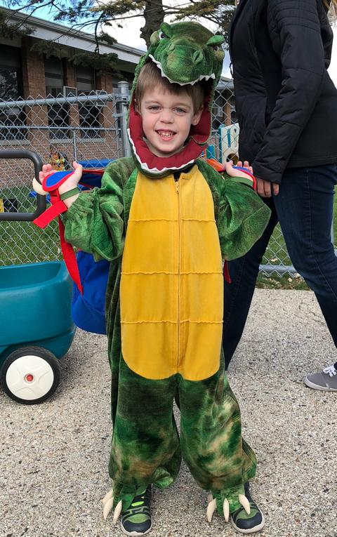 student in dragon costume