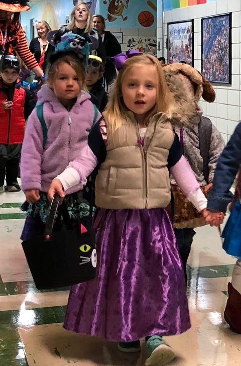 girl with winter vest over her princess costume