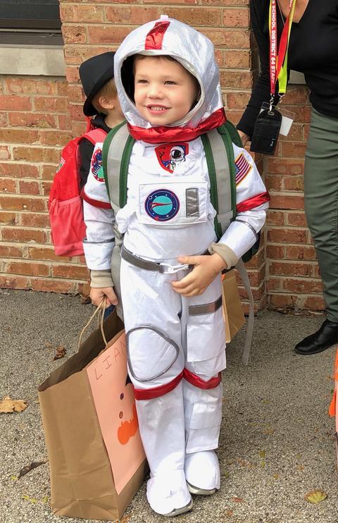 astronaut costumed student
