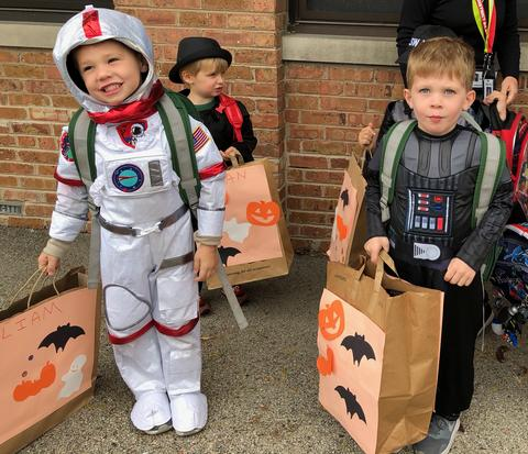 astronaut and robot costumed students