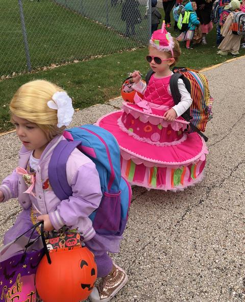 girls dressed as rapunzel and a cake